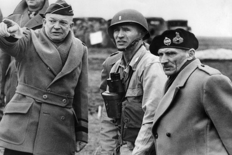 Supreme Commander of the Allied Forces and future U.S. president, General Dwight D. Eisenhower (L) with British Field Marshal Bernard Montgomery (R), his deputy commander, in an unknown location in June 1944 after Allied forces stormed the Normandy beaches.
