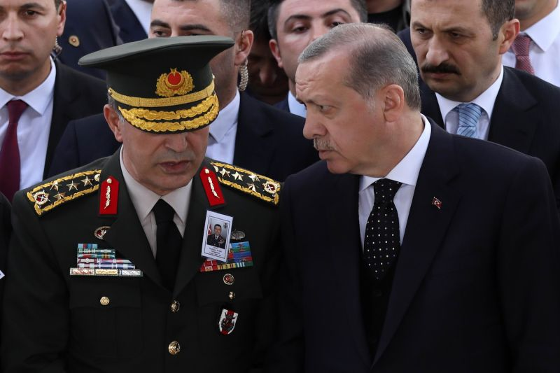 Turkish President Recep Tayyip Erdogan (R) and Chief of Staff General Hulusi Akar (L) attend the funeral of a soldier killed in a helicopter crash at Ahmet Hamdi Akseki Mosque in Ankara, on June 1, 2017.