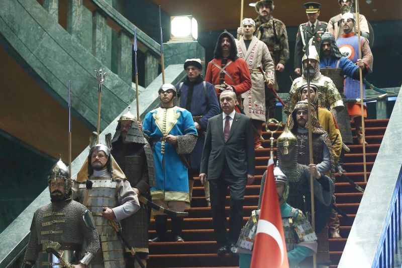 Turkey's President Recep Tayyip Erdogan walks down the stairs in between soldiers, wearing traditional army uniforms from the Ottoman Empire, as he arrives for a welcoming ceremony for Palestinian President Mahmoud Abbas at the presidential palace in Ankara, January 12, 2015.