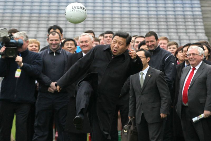 Then Chinese Vice President Xi Jinping kicks a Gaelic football  as he visits Croke Park in Dublin, Ireland, on February 19, 2012. (Peter Muhly/AFP/Getty Images)