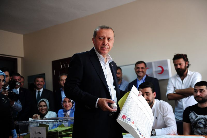 Turkish President Recep Tayyip Erdogan holds his ballot before casting his vote for Turkey's legislative election at a polling station in Istanbul on June 7, 2015. (Ozan Kose/AFP/Getty Images)