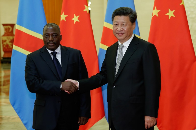 China's President Xi Jinping shakes hands with Democratic Republic of Congo's President Joseph Kabila at the Great Hall of the People in Beijing on Sept. 4, 2015. (LINTAO ZHANG/AFP/Getty Images)