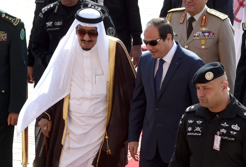 Saudi King Salman bin Abdulaziz welcomes Egyptian President Abdel Fattah al-Sisi at Riyadh international airport on November 10, 2015. (FAYEZ NURELDINE/AFP/Getty Images)