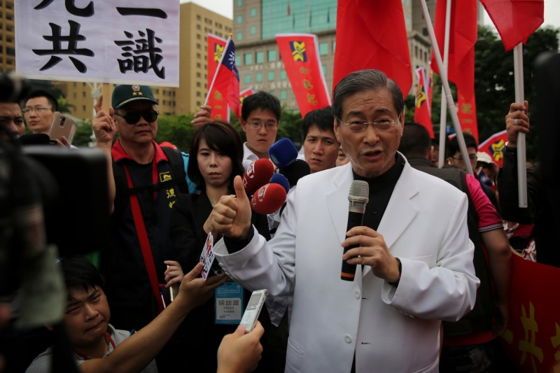 """Chang An-lo, also known as """"White Wolf,"""" leader of the China Unification Promotion Party, speaks to the media on May 20, 2016. (Isaac Lawrence/AFP/Getty Images)"""