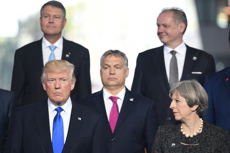 U.S. President Donald Trump, British Prime Minister Theresa May, and other leaders gather during a NATO summit on May 25, 2017 in Brussels, Belgium. (Stefan Rousseau - Pool/Getty Images)