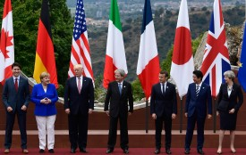Canadian Prime Minister Justin Trudeau, German Chancellor Angela Merkel, U.S. President Donald Trump, then-Italian Prime Minister Paolo Gentiloni, French President Emmanuel Macron, Japanese Prime Minister Shinzo Abe, and U.K. Prime Minister Theresa May pose for a photo at the G-7 summit in Sicily on May 26, 2017. (Miguel Medine/AFP/Getty Images)