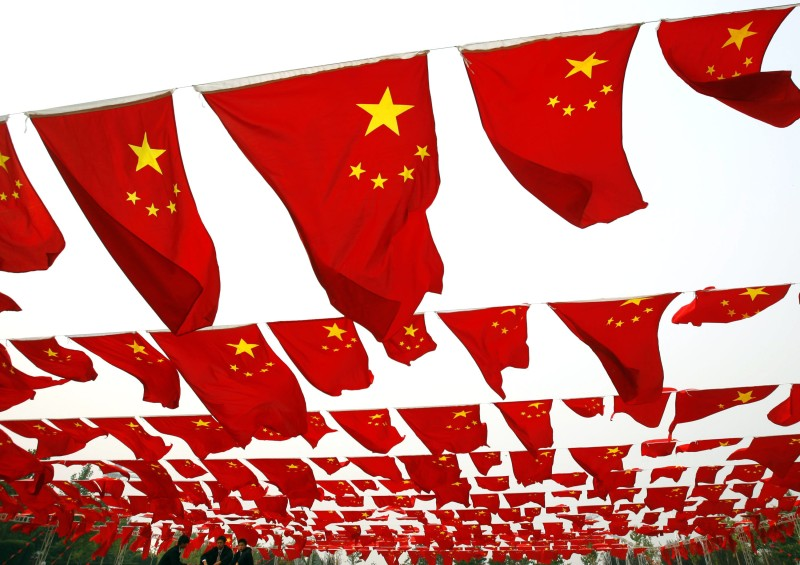 Chinese people visit a national flag show at Chaoyang park on Sep. 30, 2006 in Beijing. (China Photos/Getty Images)
