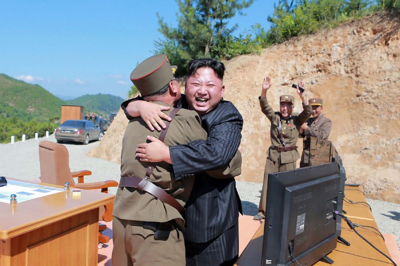 North Korean leader Kim Jong Un celebrates the successful test-fire of the intercontinental ballistic missile Hwasong-14 at an undisclosed location in July 2017. STR/AFP/Getty Images