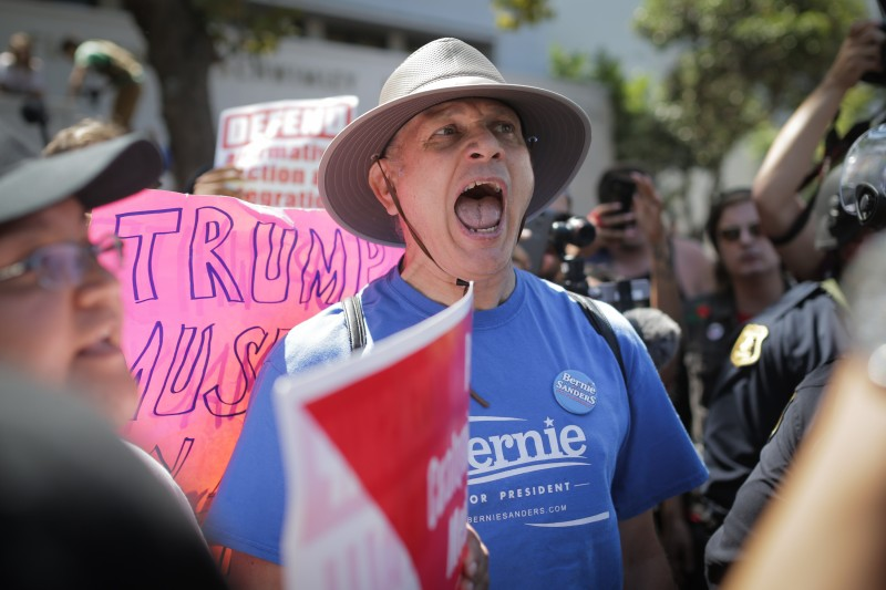 A supporter of Sen. Bernie Sanders yells at a Trump supporter at MLK Jr. Park on Aug. 27, 2017 in Berkeley, California. (Elijah Nouvelage/Getty Images)