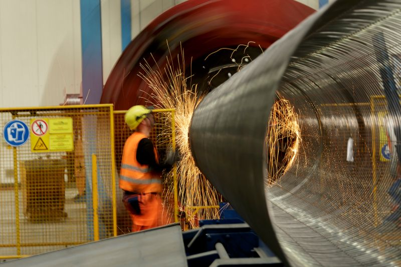 An employee works on an iron cage at the Nord Stream 2 facility in Sassnitz, Germany, in October 2017. (Carsten Koall/Getty Images)