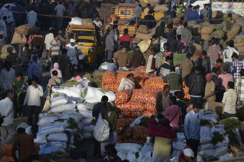 Indian farmers, traders and vendors negotiate prices of vegetables at a wholesale vegetable market in Hyderabad on February 1, 2018. (NOAH SEELAM/AFP/Getty Images)