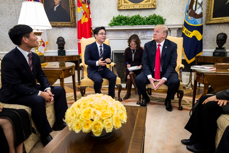 North Korean defector Ji Seong-ho speaks with U.S. President Donald Trump at the White House on Feb. 2. (Zach Gibson/Pool/Getty Images)