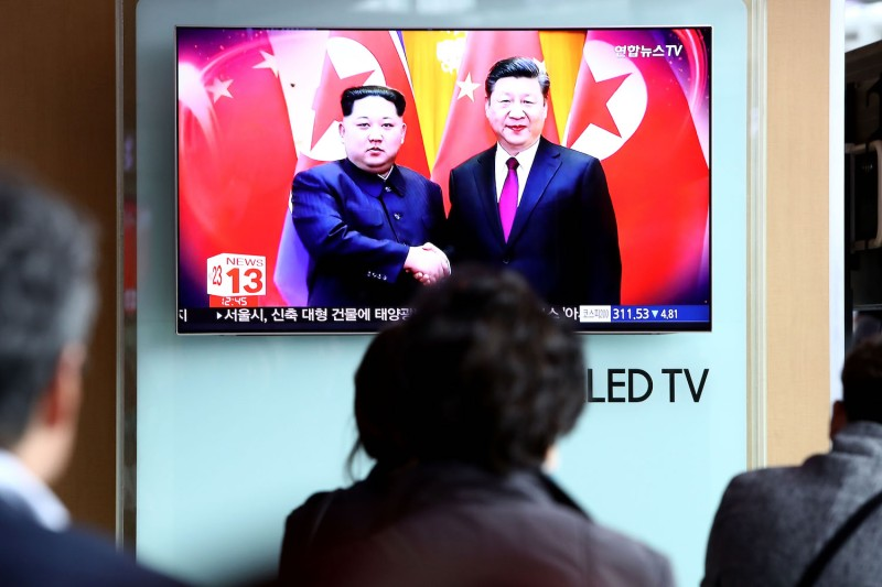A television broadcast of a meeting between North Korean leader Kim Jong Un and Chinese President Xi Jinping in Seoul, South Korea on March 28.  (Chung Sung-Jun/Getty Images)