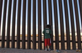 A child at the U.S.-Mexico fence in Ciudad Juárez, Mexico, on April 4. (Herika Martinez/AFP/Getty Images)