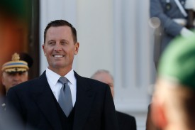 New U.S. Ambassador Richard Grenell stands in front of a military honor guard during an accreditation ceremony for new ambassadors in Berlin on May 8. (Odd Andersen/AFP/Getty Images)