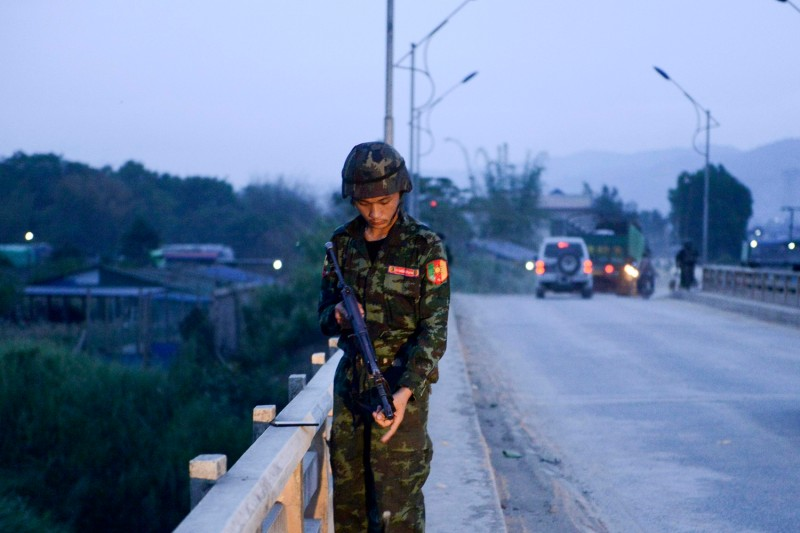 An army-linked militiaman secures a bridge in Muse, Myanmar on May 12, 2018. (AFP/Getty Images)