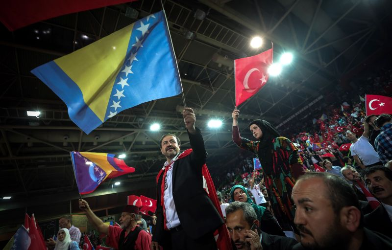 Supporters of Turkish President Recep Tayyip Erdogan wave the Turkish national flag during a pre-election rally in Sarajevo, on May 20. (Oliver Bunic/AFP/Getty Images)