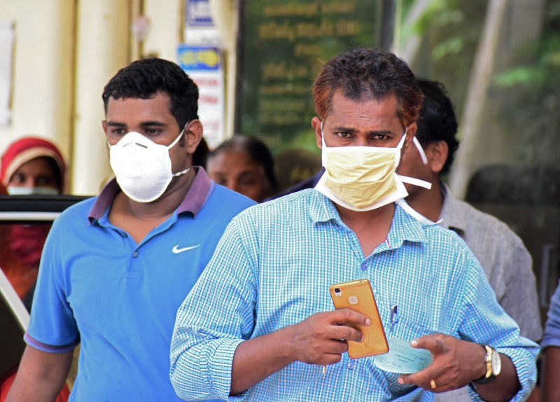 Indian residents wear face mask outside the Medical College hospital in Kozhikode on May 21, 2018. (AFP/Getty Images)