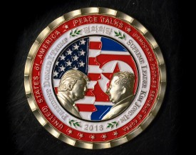 A coin for the upcoming US-North Korea summit is seen in Washington, DC, on May 21, 2018. (STR/AFP/Getty Images)