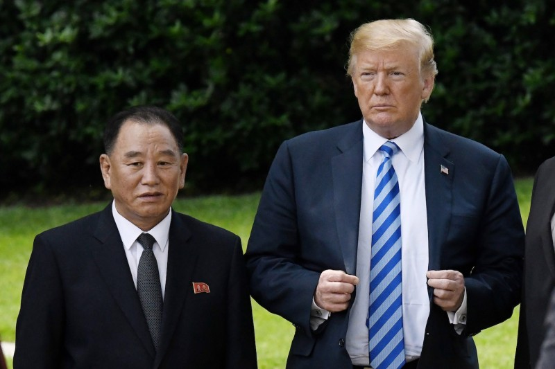President Donald Trump stands with Kim Yong Chol, former North Korean military intelligence chief and one of leader Kim Jong Un's closest aides, on the South Lawn of the White House on June 1, 2018 in Washington, DC. Photo by Olivier Douliery-Pool/Getty Images