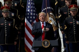 """Donald Trump sings the national anthem with a U.S. Army chorus during a """"Celebration of America"""" event on the south lawn of the White House June 5, 2018 in Washington, DC. (Win McNamee/Getty Images)"""