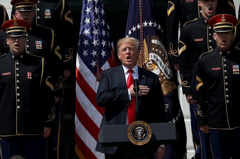 "Donald Trump sings the national anthem with a U.S. Army chorus during a ""Celebration of America"" event on the south lawn of the White House June 5, 2018 in Washington, DC. (Win McNamee/Getty Images)"