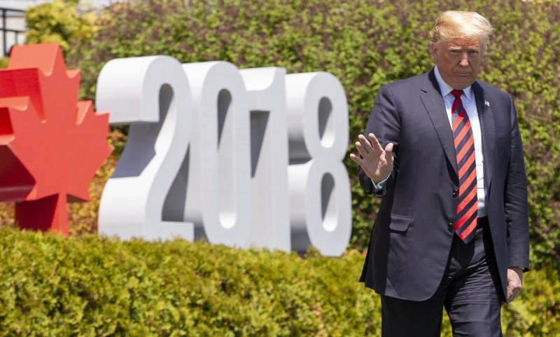 Donald Trump walks to the official G7 welcoming ceremony in La Malbaie, Quebec, Canada, June 8, 2018. (GEOFF ROBINS / AFP)