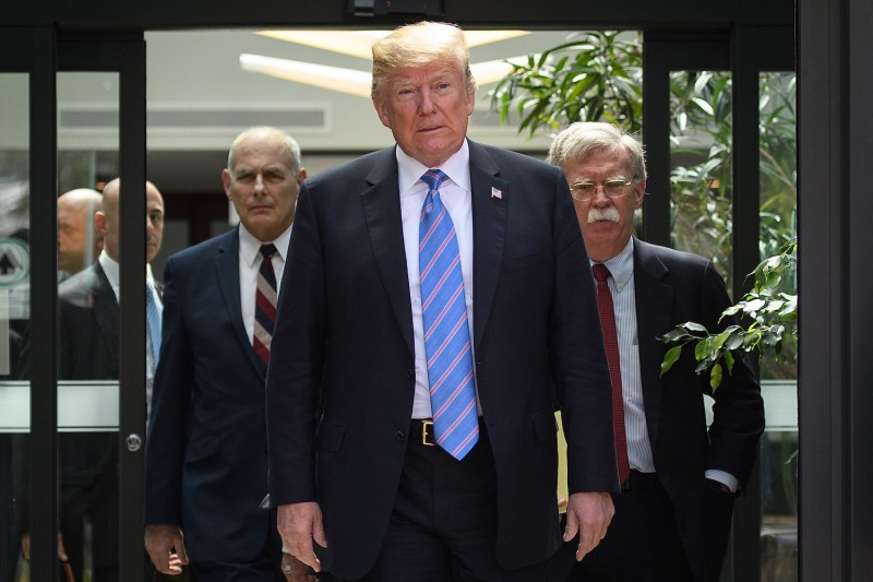 U.S. President Donald Trump, Chief of Staff John Kelly, left, and National Security Advisor John Bolton, right, at the G-7 summit in Quebec, Canada, on June 9. (Leon Neal/Getty Images)