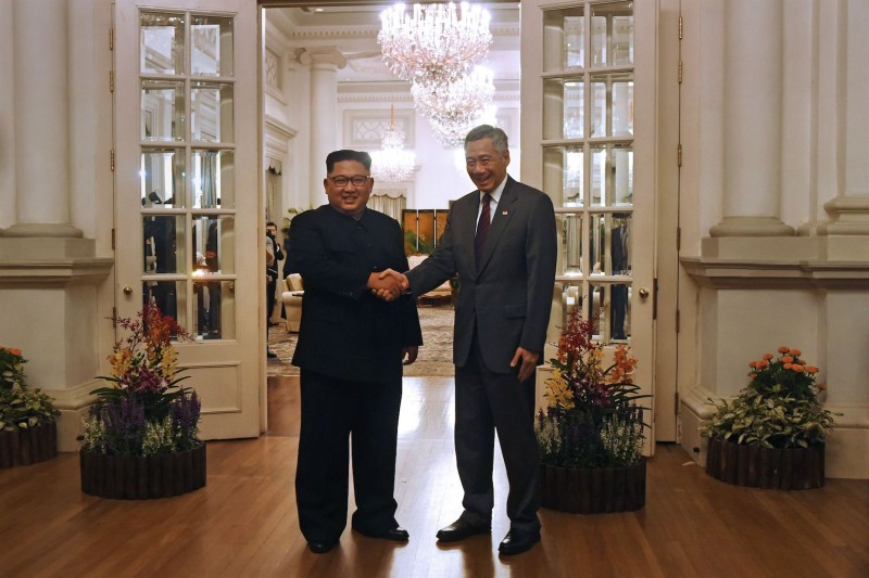 Singaporean Prime Minister Lee Hsien Loong, right, greats North Korean leader Kim Jong Un in Singapore on June 10. (Roslan Rahman/AFP/Getty Images)
