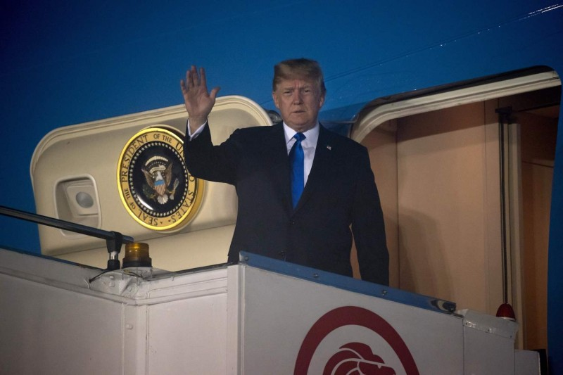 U.S. President Donald Trump waves from the door of Air Force One upon arrival in Singapore on June 10. (Saul Loeb/AFP/Getty Images)