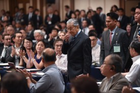 "Malaysian Prime Minister Mahathir Mohamad (C) is welcomed upon his arrival at the international conference ""The Future of Asia"" in Tokyo on June 11, 2018. (KAZUHIRO NOGI/AFP/Getty Images)"