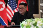 North Korea's leader Kim Jong Un reacts at a signing ceremony with US President Donald Trump  during their historic US-North Korea summit, at the Capella Hotel on Sentosa island in Singapore on June 12, 2018. (SAUL LOEB/AFP/Getty Images)