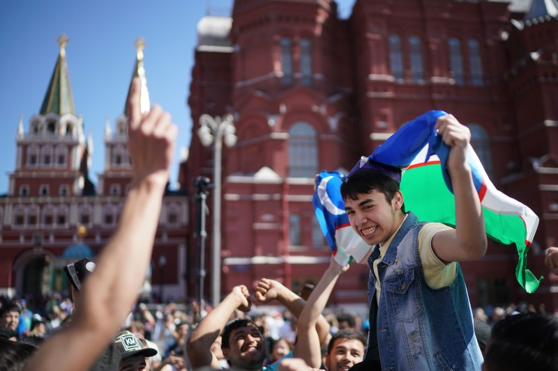 Football fans from Uzbekistan celebrate near Red Square on June 15, 2018 in Moscow, Russia.  (Photo by Christopher Furlong/Getty Images)