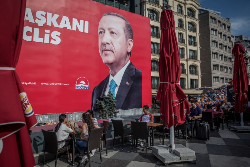 An election poster showing the portrait of Turkey's President Recep Tayyip Erdogan on June 19 in Istanbul, Turkey. (Chris McGrath/Getty Images)
