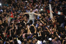 Demonstrators protest near the prime minister's office in Amman, Jordan, on June 6. (Ahmad Gharabli/AFP/Getty Images)