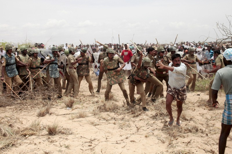 Indian police clash with protestors on the beach at Idinathakarai village near the Kudankulam Nuclear Power Plant in southern Tamil Nadu on September 10, 2012.