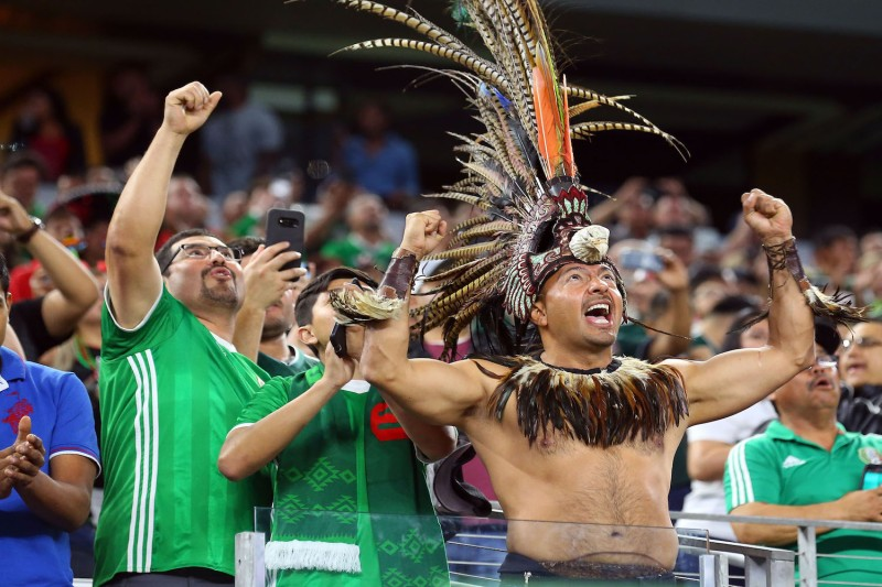Fans cheer for Mexico during an international friendly soccer match against Croatia at AT&T Stadium on March 27 in Arlington, Texas.  (Richard Rodriguez/Getty Images)