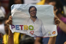 A supporter of Colombian presidential candidate Gustavo Petro for the Colombia Humana Party holds a poster during a campaign rally in Cali, Colombia, on June 9, (Luis Robayo/AFP/Getty Images)