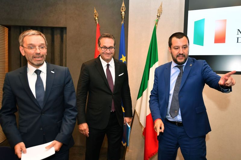 Austria's Interior Minister Herbert Kickl (L), Italy's Interior Minister and deputy Prime Minister Matteo Salvini (R) and Austria's Vice Chancellor Heinz-Christian Strache (C) arrive to give a joint press conference at the end of their meeting at the Viminale palace in Rome on June 20, 2018.