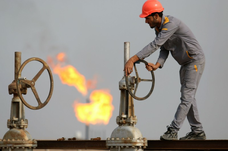 An Iraqi worker at an oil refinery in Nasiriyah, Oct. 30, 2015. (Haidar Mohammed Ali/AFP/Getty Images)