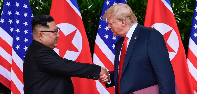 North Korea leader Kim Jong Un and U.S. President Donald Trump shake hands after their meeting in Singapore on June 12. (Susan Walsh/AFP/Getty Images)