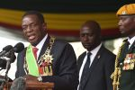 Zimbabwean President Emmerson Mnangagwa (L) gives a speech after being officially sworn in during a ceremony in Harare on November 24, 2017.