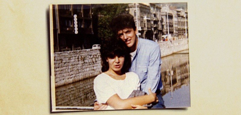 Bosnian lovers Admira Ismic (L) and Bosko Brckic, who were shot dead while trying to escape the besieged capital last week and whose bodies lay embraced in a riverfront no-man's land for 5 days, are pictured in a photograph taken on Sarajevo's Miljacka River just after their high school graduation in 1985 - PBEAHUNJDBR