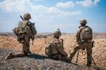 A group of U.S. soldiers keeps an eye on the demarcation line during a security patrol outside Manbij, Syria, on June 24. (U.S. Army photo by Staff Sgt. Timothy R. Koster)