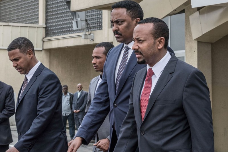 Ethiopia's Prime Minister Abiy Ahmed (R) and Ethiopia's Foreign Minister Workeneh Gebeyehu prepare to welcome an Eritrean delegation at the international airport in Addis Ababa on June 26, 2018.