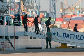 The first migrants from the Aquarius, a ship that was turned away by Italy and Malta sparking a major migration row in Europe, disembarked at the Spanish port of Valencia on June 17, 2018.