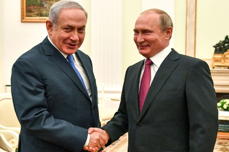 Russian President Vladimir Putin (R) shakes hands with Israeli Prime Minister Benjamin Netanyahu during their meeting at the Kremlin in Moscow on July 11, 2018.