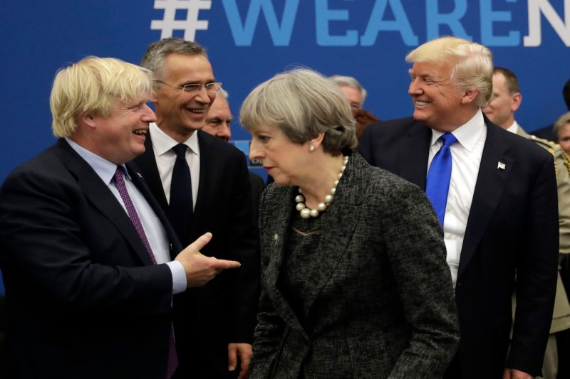 Britain's then-foreign secretary Boris Johnson, NATO Secretary General Jens Stoltenberg, Britain's Prime Minister Theresa May, and U.S. President Donald Trump arrive for a working dinner meeting at the NATO summit at the NATO headquarters, in Brussels, on May 25, 2017.