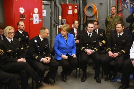 "German Chancellor Angela Merkel chats with sailors of the German Navy while she visited the ""Braunschweig"" warship on January 19, 2016 in Kiel, Germany."