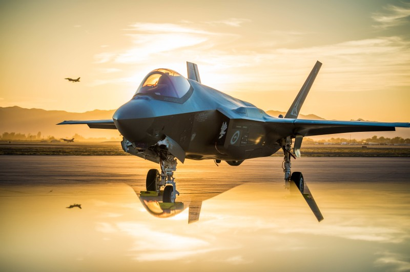 The sun sets behind an Australian F-35A Lighting II at Luke Air Force Base, Arizona, on June 27. (U.S. Air Force photo by Staff Sgt. Jensen Stidham) Note: This image was created by placing a reflective surface in front of the the camera lens.